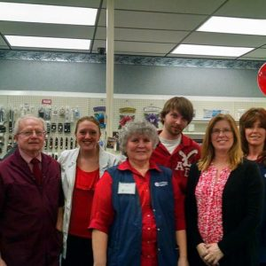 Pulaski Pharmacy wearing red